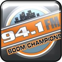 Photo taken at Boomchampionstt 94.1FM by Selvon F. on 12/13/2012