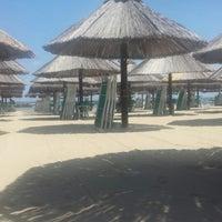 Photo taken at Nettuno Beach Club by Marcella on 6/5/2014