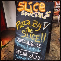 Photo taken at Slice Pizzeria by Prescotte on 5/26/2013