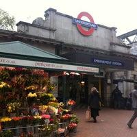 Photo taken at Embankment London Underground Station by Liz D. on 11/13/2012