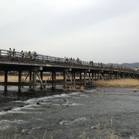 Photo taken at Togetsu-kyo Bridge by Yoshiaki I. on 3/17/2013