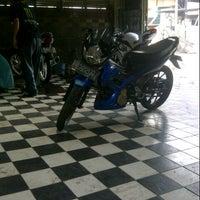 Photo taken at Motor Bridal (Tempat Cuci Motor) by Wendy W. on 9/6/2014