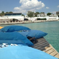 Photo taken at Medusa Beach Club by Volkan Ö. on 6/15/2013