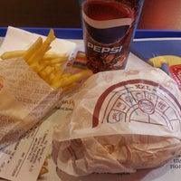 Photo taken at Burger King by Tolga B. on 12/3/2013