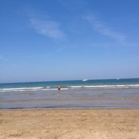 Photo taken at Les Arenes Beach by Toni U. on 6/29/2013