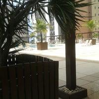 Photo taken at Piscina Hotel Oasis by Virgínia V. on 4/8/2014