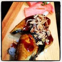 Photo taken at Sushi Dokku by Charmaine V. on 6/30/2013
