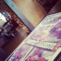 Photo taken at Country's BBQ by Lucas S. on 7/1/2014