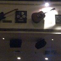 Photo taken at Hard Rock Cafe Jakarta by Noraini S. on 12/25/2012