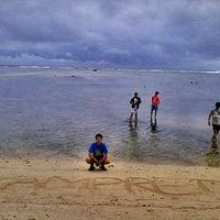 Photo taken at Pantai Ujung Genteng by Devit I. on 11/23/2012
