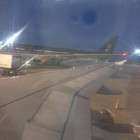 Photo taken at QAIA - Gate 11 by Mohammad A. on 1/12/2013