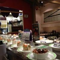 Photo taken at Sushi Factory by Edoardo on 4/3/2013