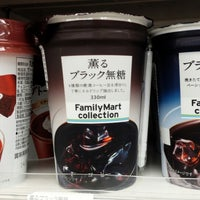 Photo taken at FamilyMart by Cafe on 5/15/2014