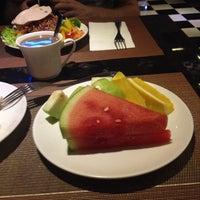 Photo taken at La Perle International Hotel by Jose Luis D. on 10/16/2013