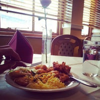 Photo taken at Namaste Kerala Indian Restaurant by Nathan S. on 3/25/2013