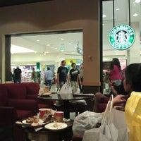 Photo taken at Starbucks by Ulker S. on 12/31/2012
