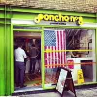 Photo taken at Poncho 8 by Andrew W. on 7/4/2013