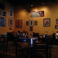 Photo taken at MOJO Bar B Que, A Southern Blues Kitchen by Dayan M. on 5/5/2013