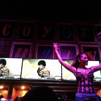 Photo taken at Coyote Ugly Saloon by Derek V. on 2/22/2014