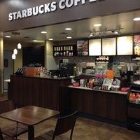 Photo taken at Starbucks by Julie F. on 5/8/2014