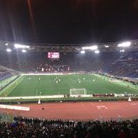 Photo taken at Stadio Olimpico by Bruno J. on 12/22/2012
