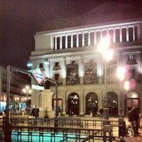 Photo taken at Plaza de Isabel II by Alex G. on 10/29/2012