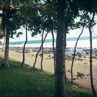 Photo taken at Petangahan Beach by Arum R. on 7/31/2013