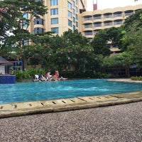 Photo taken at Swimming pool - Mercure Hotel by henry s. on 12/31/2013