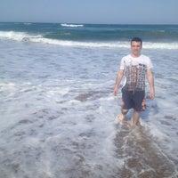 Photo taken at Amanzimtoti Main Beach by Sedat A. on 4/1/2014