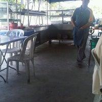 Photo taken at Warung Pak Kusno. by Alex U. on 10/31/2012