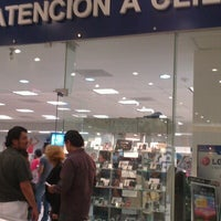 Photo taken at CAC Telcel by Laura on 12/2/2012