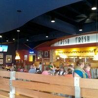 Photo taken at Boston's Restaurant & Sports Bar by Lucía F. on 8/2/2013
