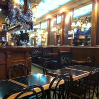 Photo taken at Café des Mousquetaires by Victoria on 1/3/2013