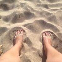 Photo taken at Leisure Bay Beach by Stella U. on 12/27/2012