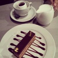 Photo taken at Lindt Chocolat Café by Stella K. on 7/27/2013
