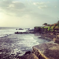 Photo taken at Tanah Lot Beach by Anna D. on 2/4/2014
