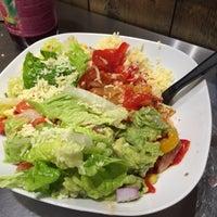 Photo taken at Tuzo Mexican Kitchen by Simon K. on 1/10/2015