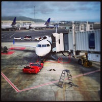 Photo taken at Gate 70 by Jay R. on 3/3/2013