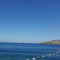 Photo taken at Greenside Beach by MERİÇ S. on 8/18/2016