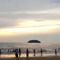 Photo taken at Tanjung Aru 1st Beach by Dongkug L. on 6/8/2013