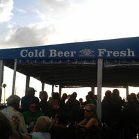 Photo taken at Olde Bay Cafe & Dunedin Fish Market by Kelsey U. on 6/22/2013