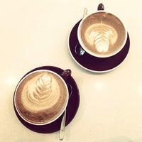 Photo taken at Moja Coffee by Joyce L. on 7/7/2014