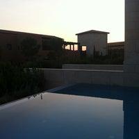Photo taken at Romanos Costa Navarino Pool by N K. on 8/5/2013