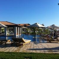 Photo taken at Romanos Costa Navarino Pool by N K. on 8/7/2013