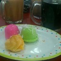 Photo taken at Mak Ungku Cafe by Roslan R. on 1/1/2013