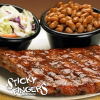 Photo taken at Sticky Fingers Ribhouse by Sticky Fingers Smokehouse - Get Sticky. Have Fun! on 7/2/2014