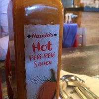 Photo taken at Nando's by Cass on 1/29/2014