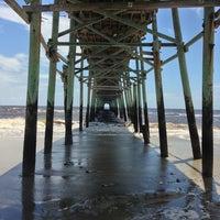 Photo taken at Oak Island Pier by Matt L. on 7/5/2013