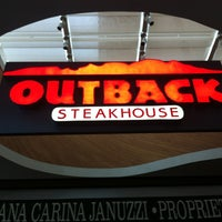 Photo taken at Outback Steakhouse by isabella p. on 7/25/2013