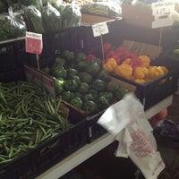 Photo taken at Charlotte Regional Farmer's Market by Jimmy S. on 6/2/2013